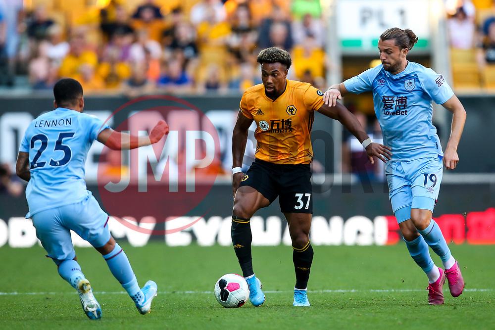Adama Traore of Wolverhampton Wanderers takes on Jay Rodriguez of Burnley - Mandatory by-line: Robbie Stephenson/JMP - 25/08/2019 - FOOTBALL - Molineux - Wolverhampton, England - Wolverhampton Wanderers v Burnley - Premier League