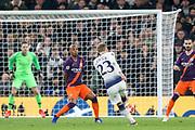Christian Eriksen midfielder of Tottenham Hotspur (23) shoots at goal during the Champions League Quarter-Final 1st leg between Tottenham Hotspur and Manchester City at Tottenham Hotspur Stadium, London, United Kingdom on 9 April 2019.