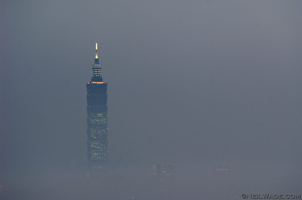 Taipei 101 seen surroounded by clouds and smog in Taipei, Taiwan.