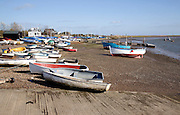 Dinghies on the shore, Orford, Suffolk, England