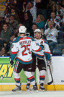 KELOWNA, CANADA - APRIL 5: Colton Heffley #25 and Tyrell Goulbourne #12 of the Kelowna Rockets celebrate a goal against the Seattle Thunderbirds on April 5, 2014 during Game 2 of the second round of WHL Playoffs at Prospera Place in Kelowna, British Columbia, Canada.   (Photo by Marissa Baecker/Getty Images)  *** Local Caption *** Colton Heffley; Tyrell Goulbourne;
