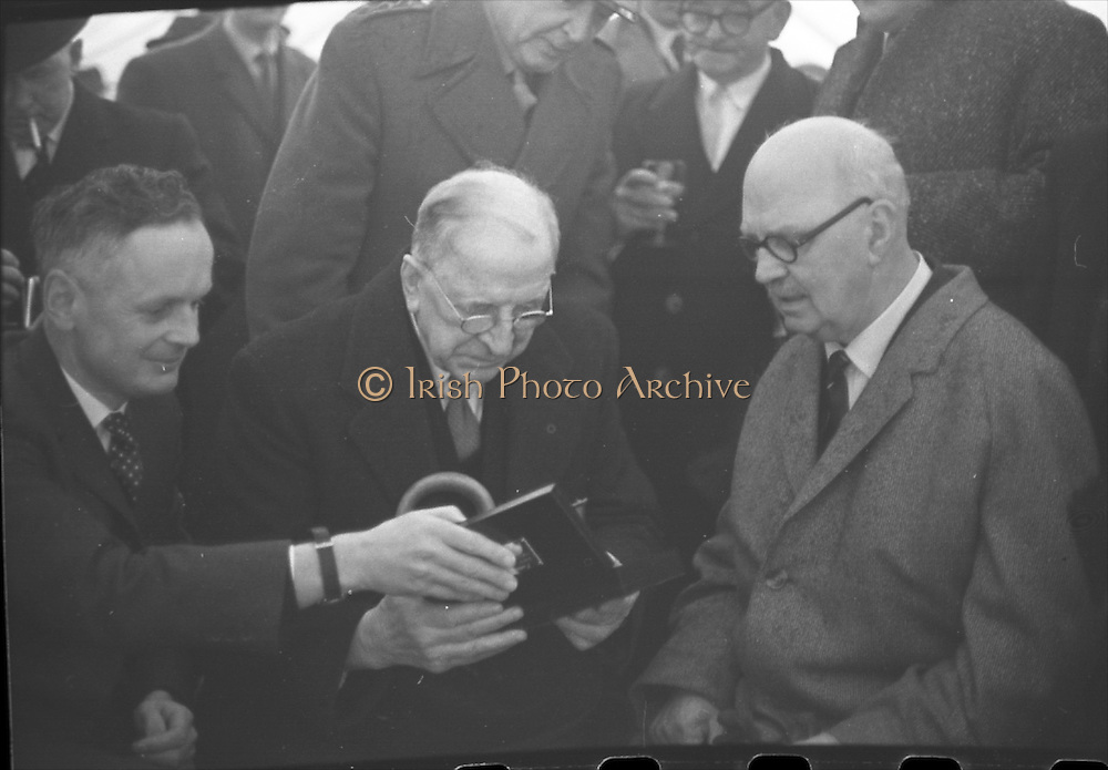 15/04/1966<br /> 04/15/1966<br /> 15 April 1966<br /> Unveiling of Plaque at Boland's Mills. President Eamon de Valera unveils a plaque to commemorate the 1916 Rising at Bolands Mills, where he was Commandant during the insurrection. Picture shows Captain E.J. Hitzen, who arrested President De Valera at Bolands Mills in 1916, chatting with the President  after 50 years at the unveiling.