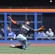 NEW YORK, NEW YORK - APRIL 13: Giancarlo Stanton, Miami Marlins, just fails to chase down a fly ball from Asdrubal Cabrera, New York Mets, during the Miami Marlins Vs New York Mets MLB regular season ball game at Citi Field on April 13, 2016 in New York City. (Photo by Tim Clayton/Corbis via Getty Images)