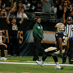 Aug 30, 2018; New Orleans, LA, USA; New Orleans Saints running back Boston Scott (30) scores against the Los Angeles Rams during the first half of a preseason game at the Mercedes-Benz Superdome. Mandatory Credit: Derick E. Hingle-USA TODAY Sports