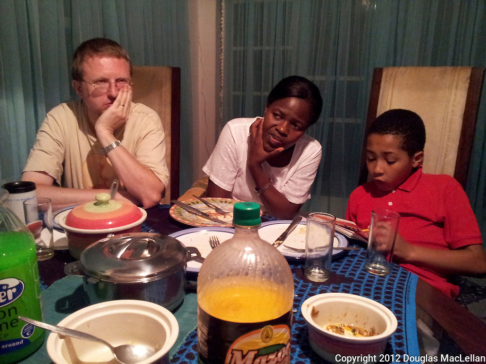 Paul Thistle, Pedrinah Thistle and their son at supper in a relative's home in Harare, Zimbabwe.