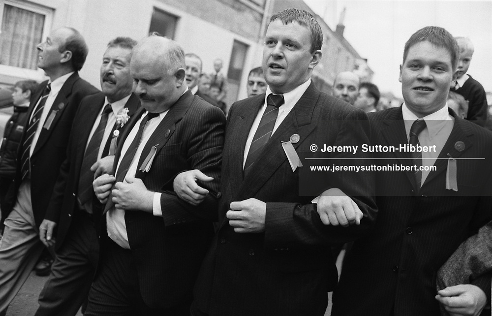 Men march around their town, singing songs, the night before the male only 'ride out' of horsemen to re-enforce the town boundaries, during Hawick Common Riding week.. Scotland..PIC©JEREMY SUTTON-HIBBERT 2000..