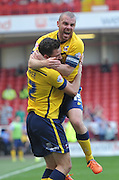 Tom Hopper of Scunthorpe United  celebrtates scoring goal to go 1-0 up with Stephen Dawson of Scunthorpe United   during the Sky Bet League 1 match between Sheffield Utd and Scunthorpe United at Bramall Lane, Sheffield, England on 8 May 2016. Photo by Ian Lyall.