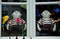 Tweedledee and Tweedledum in chocolate shop window in Antwerp, Belgium