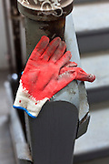 rubberized fabric work gloves laying on a stairwell post