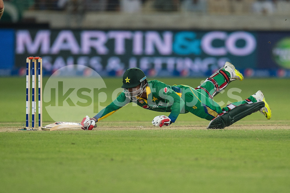 Ahmed Shehzad of Pakistan dives for the line during the 2nd International T20 Series match between Pakistan and England at Dubai International Cricket Stadium, Dubai, UAE on 27 November 2015. Photo by Grant Winter.