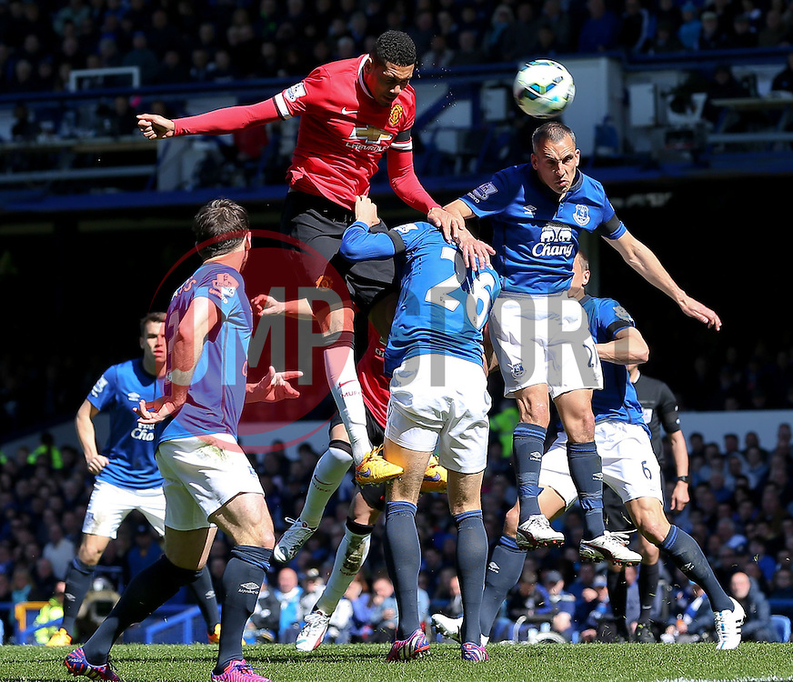 Chris Smalling of Manchester United fires a header towards goal   - Photo mandatory by-line: Matt McNulty/JMP - Mobile: 07966 386802 - 26/04/2015 - SPORT - Football - Liverpool - Goodison Park - Everton v Manchester United - Barclays Premier League