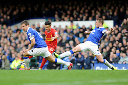 Liverpool's Philippe Coutinho takes a shot at goal. - Photo mandatory by-line: Dougie Allward/JMP - Tel: Mobile: 07966 386802 23/11/2013 - SPORT - Football - Liverpool - Merseyside derby - Goodison Park - Everton v Liverpool - Barclays Premier League