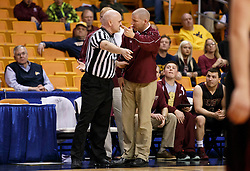 Williamstown Head Coach Scott Sauro has a discussion with one of the refs about a call during a semi final round game at the Charleston Civic Center.