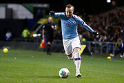 Angelino (12) of Manchester City on the ball during the EFL Cup match between Oxford United and Manchester City at the Kassam Stadium, Oxford, England on 18 December 2019.