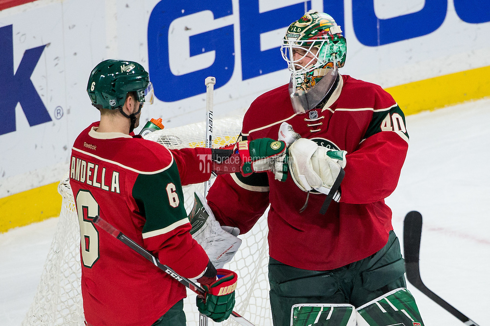 Dec 13, 2016; Saint Paul, MN, USA; Minnesota Wild goalie Devan Dubnyk (40) celebrates with defenseman Marco Scandella (6) following the game against the Florida Panthers at Xcel Energy Center. The Wild defeated the Panthers 5-1. Mandatory Credit: Brace Hemmelgarn-USA TODAY Sports