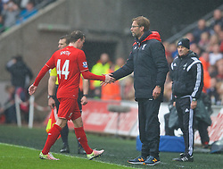 SWANSEA, WALES - Sunday, May 1, 2016: Liverpool's Brad Smith walks past manager Jürgen Klopp after being shown a second yellow and the a red card and sent off during the Premier League match against Swansea City at the Liberty Stadium. (Pic by David Rawcliffe/Propaganda)