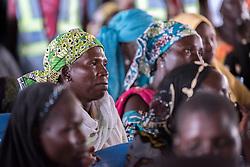 31 May 2019, Mokolo, Cameroon: Refugees wait their turn, at a distribution of non-food items in Minawao. The Minawao camp for Nigerian refugees, located in the Far North region of Cameroon, hosts some 58,000 refugees from North East Nigeria. The refugees are supported by the Lutheran World Federation, together with a range of partners.