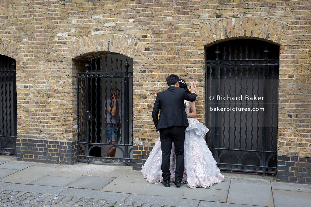 A Chinese wedding couple have their visit to England photographed and filmed, part of the Asian European wedding trip industry, on 6th September 2017, in London, England.