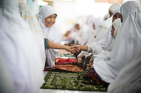 Junior High and High School students study at the Islamic School, which offers both national and Islamic curriculum, in Banda Aceh, on Tuesday, Nov. 10, 2009.