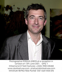 Photographer FERGUS GREER at a reception in London on 13th June 2001.<br />