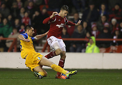 Nottingham Forest's Jamie Paterson is tackled by Preston North End's Bailey Wright - Photo mandatory by-line: Matt Bunn/JMP - Tel: Mobile: 07966 386802 24/01/2014 - SPORT - FOOTBALL - City Ground - Nottingham - Nottingham Forest v Preston North End - FA Cup - Fourth Round
