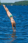 DIving competition in summer festival in Muskoka COuntry<br />