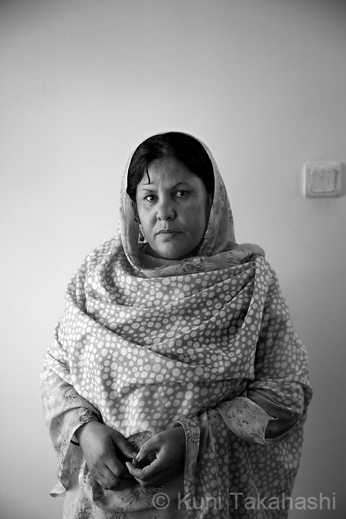 Shakila, 37, House cleaner  .in Kabul, Afghanistan on Aug 25, 2011.(Photo by Kuni Takahashi)