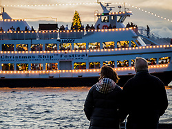 USA, Washington, Bellevue. Annual Christmas Ships display of lighted boats on Lake Washington.