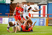 Bradford Bulls winger Omari Caro (18) juggles the ball before scoring a try to make the score  10-16 during the Kingstone Press Championship match between Sheffield Eagles and Bradford Bulls at, The Beaumont Legal Stadium, Wakefield, United Kingdom on 3 September 2017. Photo by Simon Davies.
