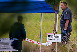 Police investigators at the scene of a multiple shooting and house fire which claimed 3 lives and left a man wounded at Mt Tiger, near Whangarei, New Zealand, Thursday, July 27, 2017. Credit:SMPA / Malcolm Pullman **NO ARCHIVING**