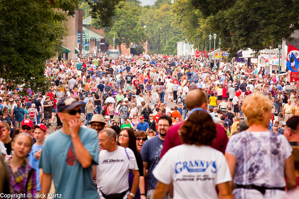 """03 SEPTEMBER 2011 - ST. PAUL, MN: The crowd walks through the Minnesota State Fair on Saturday September 3. The Minnesota State Fair is one of the largest state fairs in the United States. It's called """"the Great Minnesota Get Together"""" and includes numerous agricultural exhibits, a vast midway with rides and games, horse shows and rodeos. Nearly two million people a year visit the fair, which is located in St. Paul.   PHOTO BY JACK KURTZ"""
