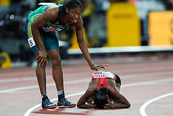 London, 2017 August 07. Caster Semenya, South Africa's bronze winner, congratulates Faith Chepngetich Kipyegon, Kenya's gold medal winner in the women's 1,500m final on day four of the IAAF London 2017 world Championships at the London Stadium. © Paul Davey.