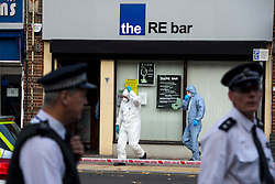 © Licensed to London News Pictures. 11/10/2015. London, UK. Police forensics officers at the scene outside the RE bar in Field End Road, Eastcote, Hillingdon where a man was stabbed to death early this morning (SUN). The victim is believed to be  21-year-old Josh Hanson from Kingsbury.  Photo credit: Ben Cawthra/LNP