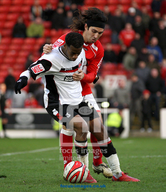 Barnsley - Saturday 21st February 2009 : Therry Racon of Charlton Athletic & Hugo Colace of Barnsley battle for the ball during the Coca Cola Championship match at Oakwell, Barnsley. (Pic by Steven Price/Focus Images)