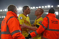 Football - 2017 / 2018 FA Cup - Fourth Round : Southampton vs. Watford<br /> <br /> Ben Watson of Watford restrains Jose Holebas of Watford  as some of the fans vent there frustration at the players after the final whistle at St Mary's Stadium Southampton<br /> <br /> COLORSPORT/SHAUN BOGGUST