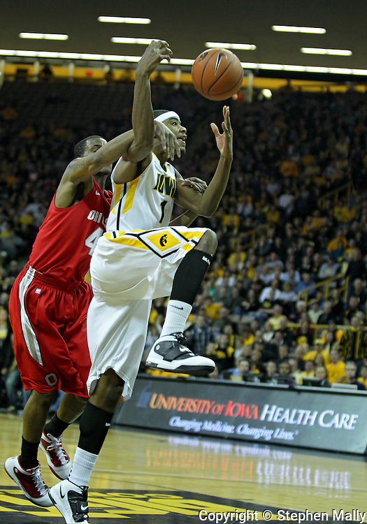 January 04 2010: Ohio State Buckeyes guard William Buford (44) is call for an intentional foul on Iowa Hawkeyes forward Melsahn Basabe (1) during the first half of an NCAA college basketball game at Carver-Hawkeye Arena in Iowa City, Iowa on January 04, 2010. Ohio State defeated Iowa 73-68.