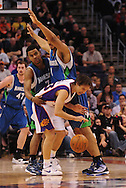 Mar. 16 2010; Phoenix, AZ, USA; Phoenix Suns guard Steve Nash (13) is guarded by Minnesota Timberwolves guard Ramon Sessions (7) and center Ryan Hollins (1) in the first half at the US Airways Center. Mandatory Credit: Jennifer Stewart-US PRESSWIRE.
