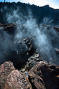 Steam sneaks out of the cracks in the rocks at Volcano National Park on the Big Island of Hawaii.