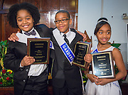 Amari Venzor of Cornelius Elementary School, left, Byron Roberson of Dodson ES, center, and Chrystyna Haywood of Bruce ES, right, pose for a photograph after their winning performances during the Martin Luther King, Jr. Oratory Competition at Antioch Missionary Baptist Church, January 17, 2014.