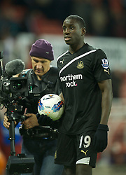 STOKE-ON-TRENT, ENGLAND - Monday, October 31, 2011: Newcastle United's hat-trick hero Demba Ba walks off with the match-ball after his side's 3-1 victory over Stoke City during the Premiership match at the Britannia Stadium. (Pic by David Rawcliffe/Propaganda)