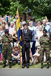 © Licensed to London News Pictures. 30/06/2013. London, UK. Flanked by two Army Cadets, a Royal British Legion standard bearer stands on parade in Southwark, London, today (30/06/2013) as part of Armed Forces Day celebrations held across the country during the weekend. . Units, including City of London Field Hospital Volunteers, The Royal Marines Reserve (City of London), RMR London, The London Irish Rifles: 'D' Company and The London Regiment, all units with connections to the Southwark, were today presented with the freedom of the borough as part of Armed Forces Day celebrations. Photo credit: Matt Cetti-Roberts/LNP
