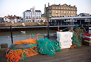 Fishing nets and boxes on Ha Penny pier, Pier Hotel and Former Great Eastern Hotel in background, Harwich, Essex