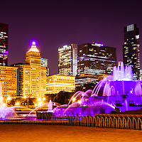 Photo of Chicago at night with Buckingham Fountain and Chicago skyline buildings.  Officially named the Clarence F. Buckingham Memorial Fountain, the fountain is a very popular attraction located in Grant Park in downtown Chicago. Image is high resolution and was taken in 2012.
