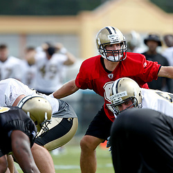 July 29, 2011; Metairie, LA, USA; New Orleans Saints quarterback Drew Brees (9) under center during the first day of training camp at the New Orleans Saints practice facility. Mandatory Credit: Derick E. Hingle