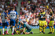 Assistance from the bench for injured Yan Valery (Southampton) during the Premier League match between Brighton and Hove Albion and Southampton at the American Express Community Stadium, Brighton and Hove, England on 24 August 2019.