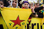 Frankfurt | 18 March 2017<br /> <br /> Am Samstag (18.02.2017) feierten &uuml;ber 30000 Kurden im Rahmen einer Demonstration das kurdische Neujahrsfest Newroz, bei der Demo sprachen sie sich gegen eine Diktatur und f&uuml;r die Freilassung von PKK-F&uuml;hrer Abdullah &Ouml;calan aus.<br /> Hier: Die Kundgebung nach der Demo findet im Europaviertel statt, eine Frau in kurdischer Tracht h&auml;lt eine Fahne der YPG mit einem roten Stern.<br /> <br /> photo &copy; peter-juelich.com<br /> <br /> Nutzung honorarpflichtig!