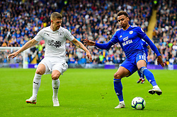 Josh Murphy of Cardiff City is marked by Johann Gudmundsson of Burnley - Mandatory by-line: Ryan Hiscott/JMP - 30/09/2018 -  FOOTBALL - Cardiff City Stadium - Cardiff, Wales -  Cardiff City v Burnley - Premier League