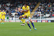 AFC Wimbledon striker Lyle Taylor (33) and Rochdale FC midfielder Matthew Lund (8) tussle during the EFL Sky Bet League 1 match between Rochdale and AFC Wimbledon at Spotland, Rochdale, England on 27 August 2016. Photo by Stuart Butcher.