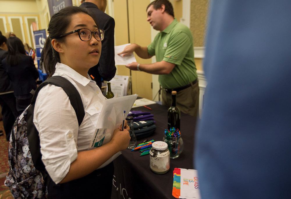 """Trayu Huang listens to a representative at """"Meet the Accountants"""" on Thursday. Photo by Katelyn Vancouver"""