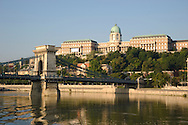 The Chain Bridge over the Danube River and Castle Hill seen from a boat in Budapest, Hungary